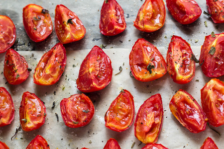 mini oven: Sun dried tomatoes on white baking paper view from above