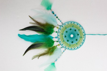 Dreamcatcher made of feathers leather beads and ropes, hanging