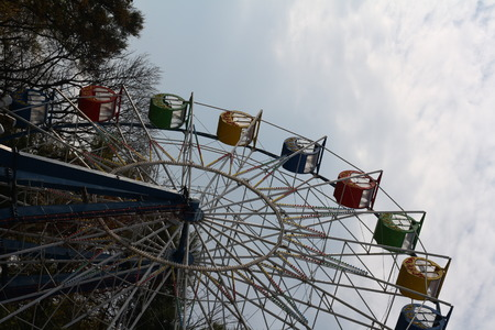 Colored Booths of Ferris wheel at an autumn park. Stock Photo