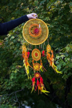 talisman: Dreamcatcher made of feathers leather beads and ropes, hanging
