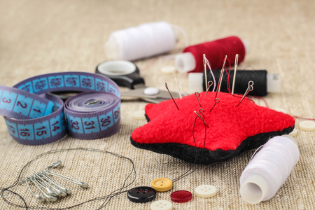 needle laces: pin cushion with needles,thread and buttons for sewing