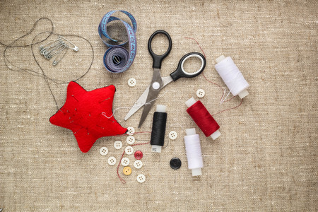 darning needle: pin cushion with needles,thread and buttons for sewing