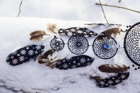 Dreamcatcher made of feathers, leather, beads, and ropes Stock Photo