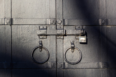 lintel: Lock with a latch on an old metal door in black
