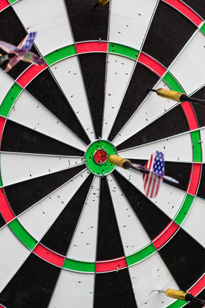 consistency: dart in bullseye on the target with many other Darts. the concept of business success