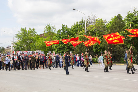soviet flag: NOVOCHERKASSK, RUSSIA - MAY 9, 2017 - Victory Day: The immortal regiment parade in the centre of the city of Novocherkassk. People with portraits of the victims of the Second World war.