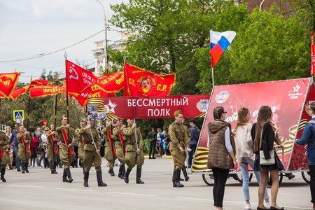 NOVOCHERKASSK, RUSSIA - MAY 9, 2017 - Victory Day: The immortal regiment parade in the centre of the city of Novocherkassk. People with portraits of the victims of the Second World war.