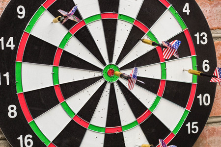 dart in bullseye on the target with many other Darts. the concept of business success