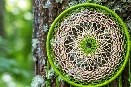 net: Colorful Dreamcatcher made of feathers leather beads and ropes, hanging, handmade