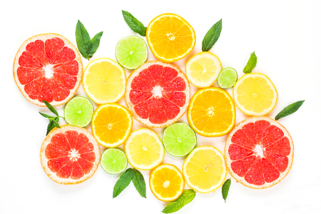 citrus food pattern on white background - assorted citrus fruits with mint leaves. Isolated on white background.