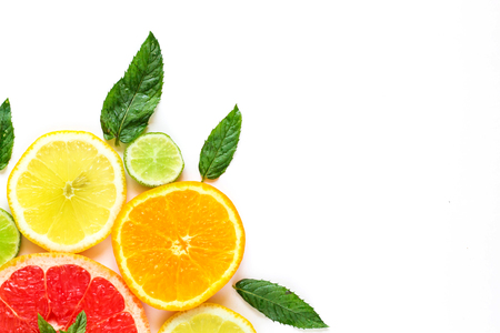 citrus food corner on white background - assorted citrus fruits with mint leaves. Isolated on white background.