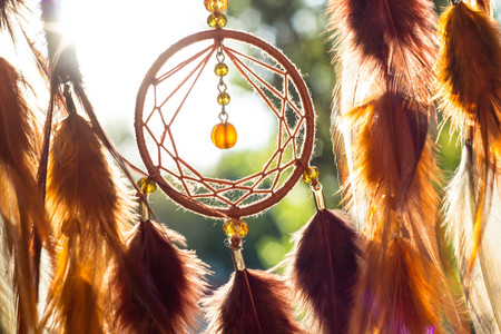 Dream catcher with feathers threads and beads rope hanging. Dreamcatcher handmade Фото со стока - 88791388