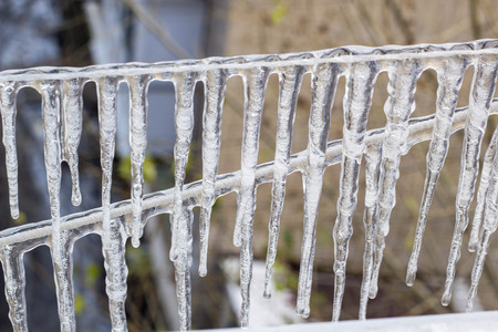 Garland from icicles on a rope in winter Stock Photo