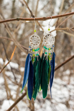 earrings of Dream catcher with feathers threads and beads rope hanging. Dreamcatcher handmade.