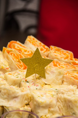 lavash roll with filling on plate with decorated gold star for holiday christmas Stock Photo