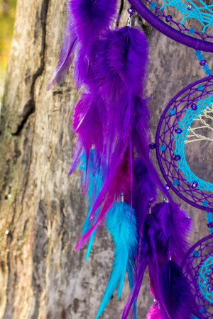Dream catcher with feathers threads and beads rope hanging. Dreamcatcher handmade Stock Photo - 114287906