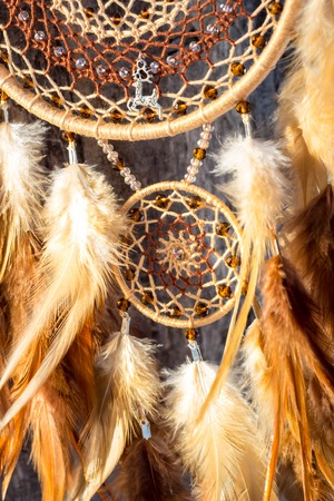 Dream catcher with feathers threads and beads rope hanging. Dreamcatcher handmade Stock fotó - 114287911