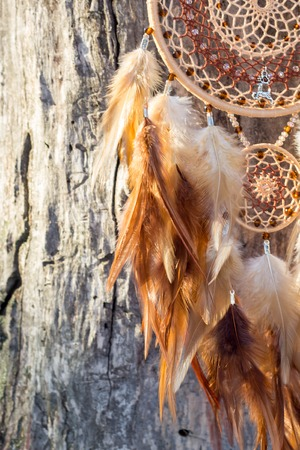 Dream catcher with feathers threads and beads rope hanging. Dreamcatcher handmade Stock fotó - 114287912