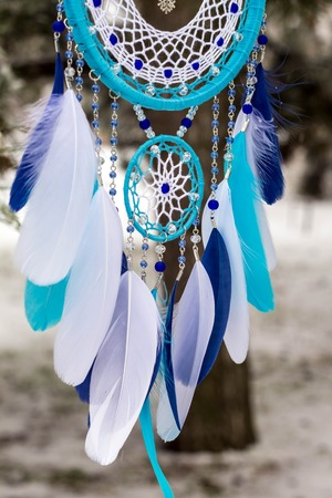 Dream catcher with feathers threads and beads rope hanging. Dreamcatcher handmade Stock Photo - 114287849