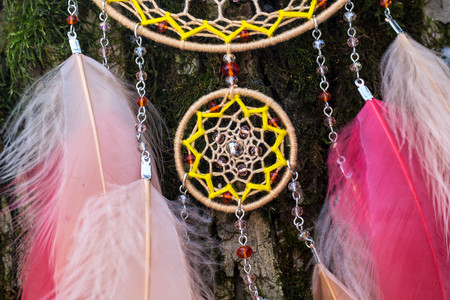 Dream catcher with feathers threads and beads rope hanging. Dreamcatcher handmade Stock Photo - 116073206