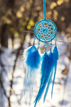 Dream catcher with feathers threads and beads rope hanging. Dreamcatcher handmade Stock Photo - 116073481