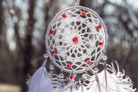 Dream catcher with feathers threads and beads rope hanging. Dreamcatcher handmade Stock Photo - 119283924