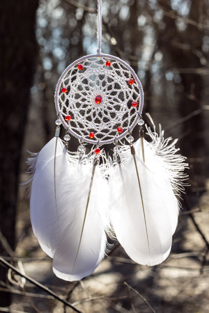 Dream catcher with feathers threads and beads rope hanging. Dreamcatcher handmade Stock Photo - 119283927