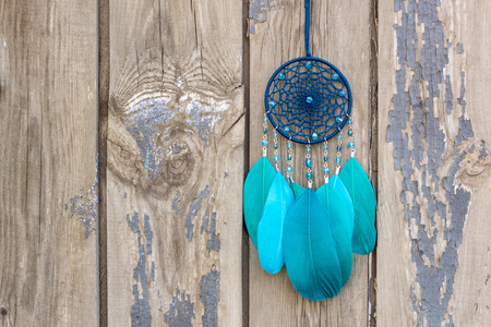 Dream catcher with feathers threads and beads rope hanging. Dreamcatcher handmade Stock Photo - 124867615