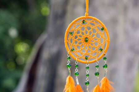 Dream catcher with feathers threads and beads rope hanging. Dreamcatcher handmade Stock Photo - 125561813