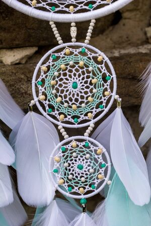 Dream catcher with feathers threads and beads rope hanging. Dreamcatcher handmade Stock Photo - 127121000