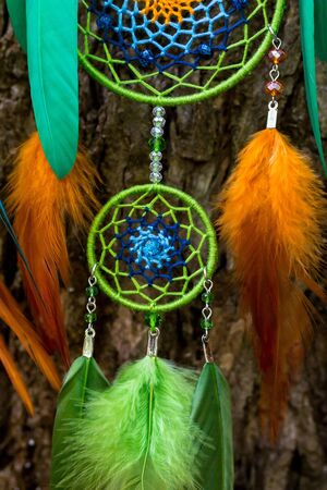 Dream catcher with feathers threads and beads rope hanging. Dreamcatcher handmade Stock Photo - 127121002