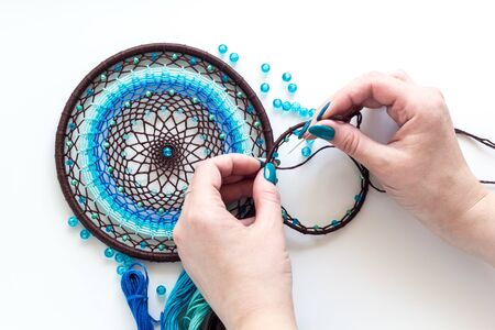 Process of creating a dream catcher. Dreamcatcer handmade. Art Creativity Hobby Workshop Handicraft Decoration Concept on white background