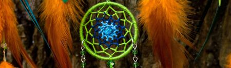 banner of Dream catcher with feathers threads and beads rope hanging. Dreamcatcher handmade