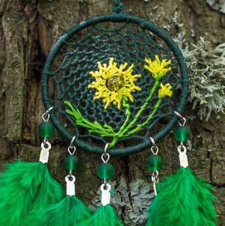 Colorful Dreamcatcher made of feathers leather beads and ropes, hanging, handmade Stock Photo - 130119891