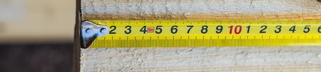banner of Yellow Measuring tape measure on the board