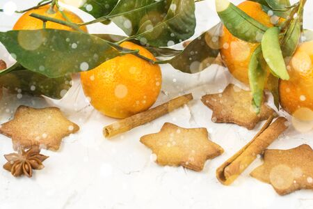 Christmas star cookies with spices and mandarin on white background with copyspace. Top view Stock fotó