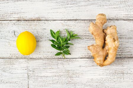 fresh ginger lemon and mint on white wooden background. Copy space Stok Fotoğraf