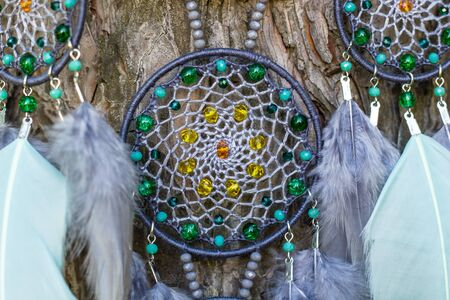 Dream catcher with feathers threads and beads rope hanging. Dreamcatcher handmade