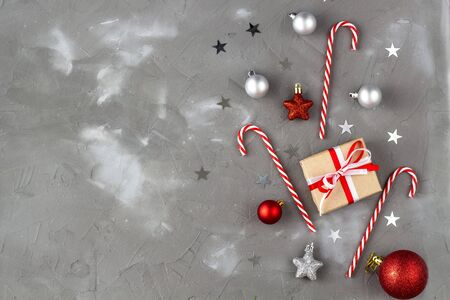 Christmas candy cane red and silver balls stars. New year celebration concept with gift Stock Photo