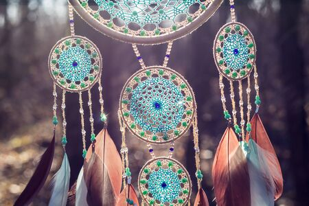 Dream catcher with feathers threads and beads rope hanging. Dreamcatcher handmade Foto de archivo