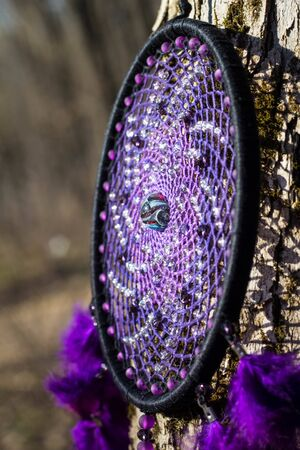 Dream catcher with feathers threads and beads rope hanging. Dreamcatcher handmade Stock Photo