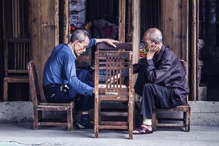 old people: July 16, 2016 old city street, Shantou, China, old people playing chess Editorial