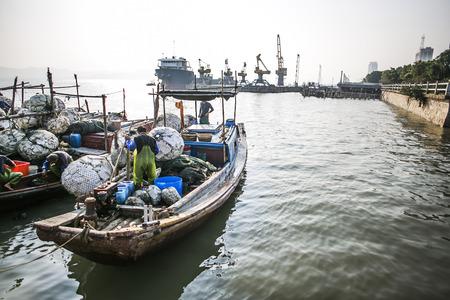 fisherman and fishing boats