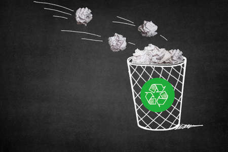 thrown: Waste paper is thrown into the trash can, environmental protection Stock Photo