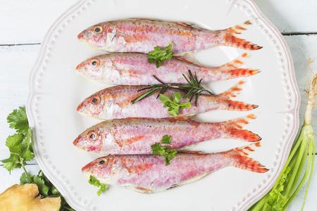 Fresh surmullet on a plate close-up, horizontal Stock Photo