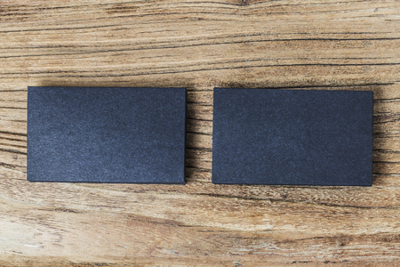 stack of blank black business cards on wooden background stock photo