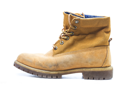 Pair of old yellow working boots,Nostalgic Stock Photo