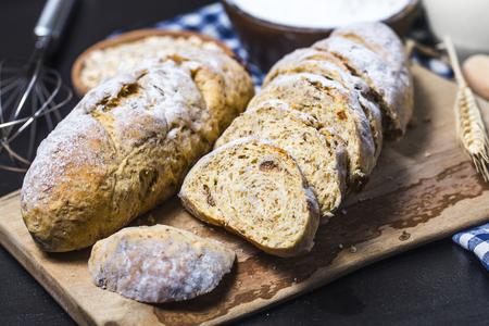 banana bread: Freshly baked traditional bread on wooden table Oatmeal Bread