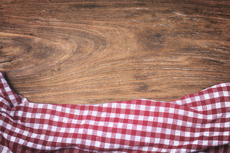 red napkin with wooden background