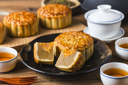 tradition: Mooncake served with hot Chinese tea Stock Photo
